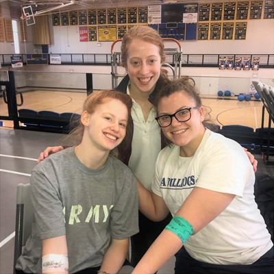SUA Blood Drive organizer Sarah Geraghty '18 (back row) encourages friends and committee members Lucie Roberts '18 of Hyde Park and Abby Kelly '18 of Anderson Township, who gave blood on Valentine's Day.