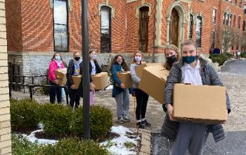 Student Carry Food Donations