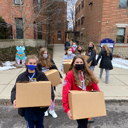Students Carry Food Donation  Boxes