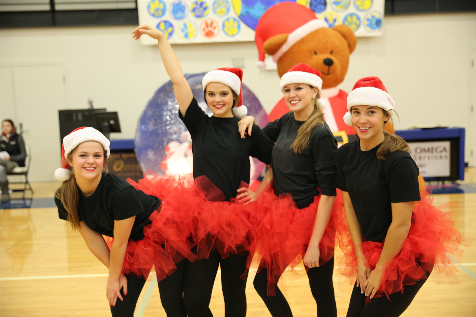 Santa Hats and tutus for a performance at the Pep Rally