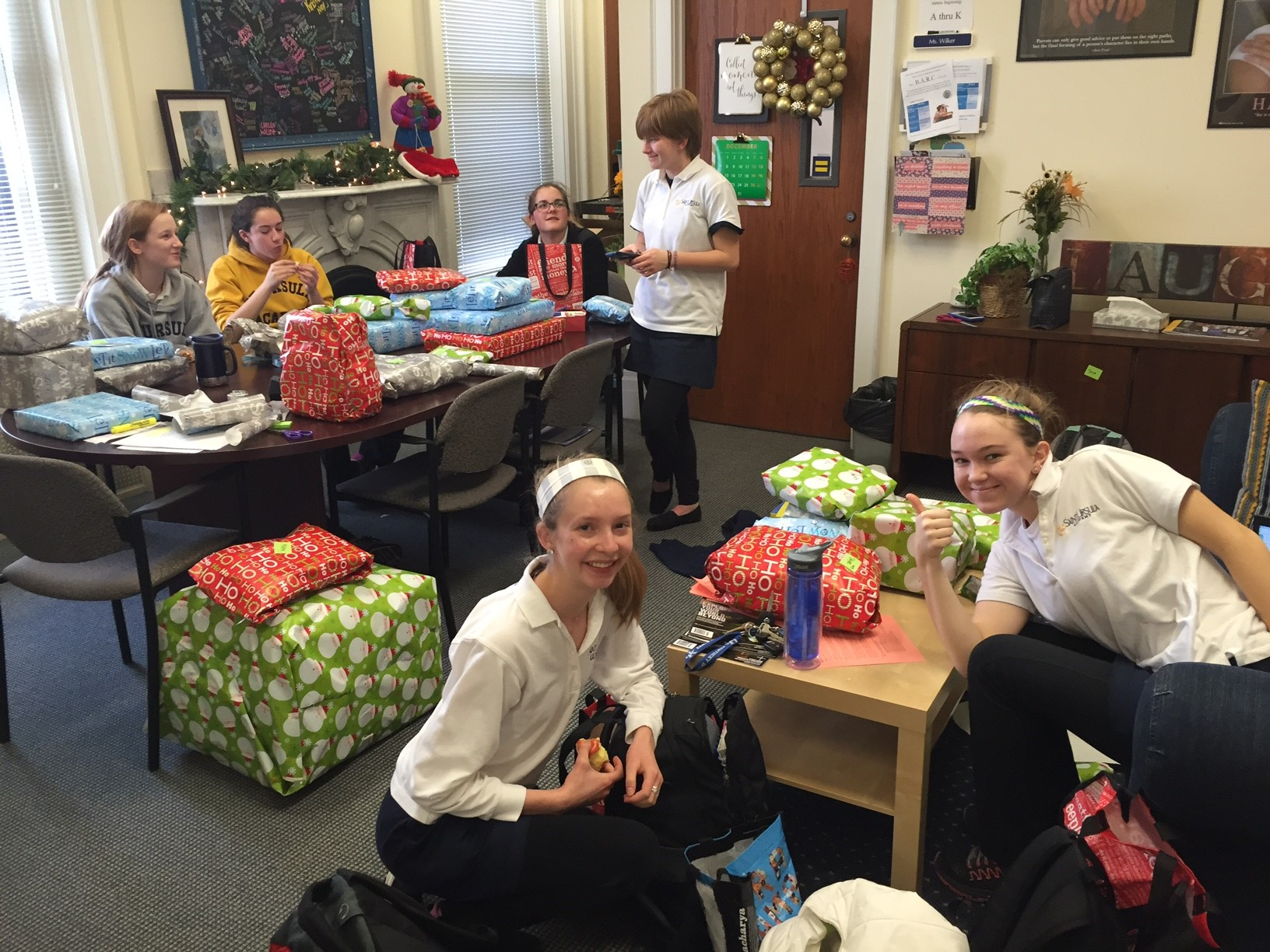 "Fellowship of Christian Athletes (FCA) purchased and wrapped Christmas gifts for an ""adopted"" family"