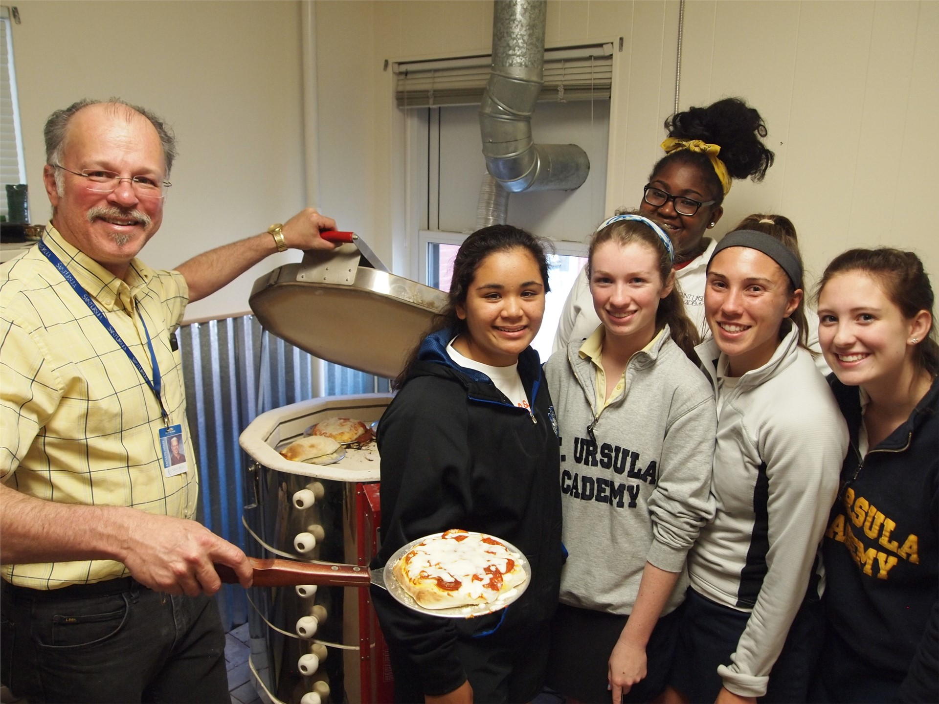 Pottery Students Enjoy the End of the School Year by Making Pizza in the Kiln!