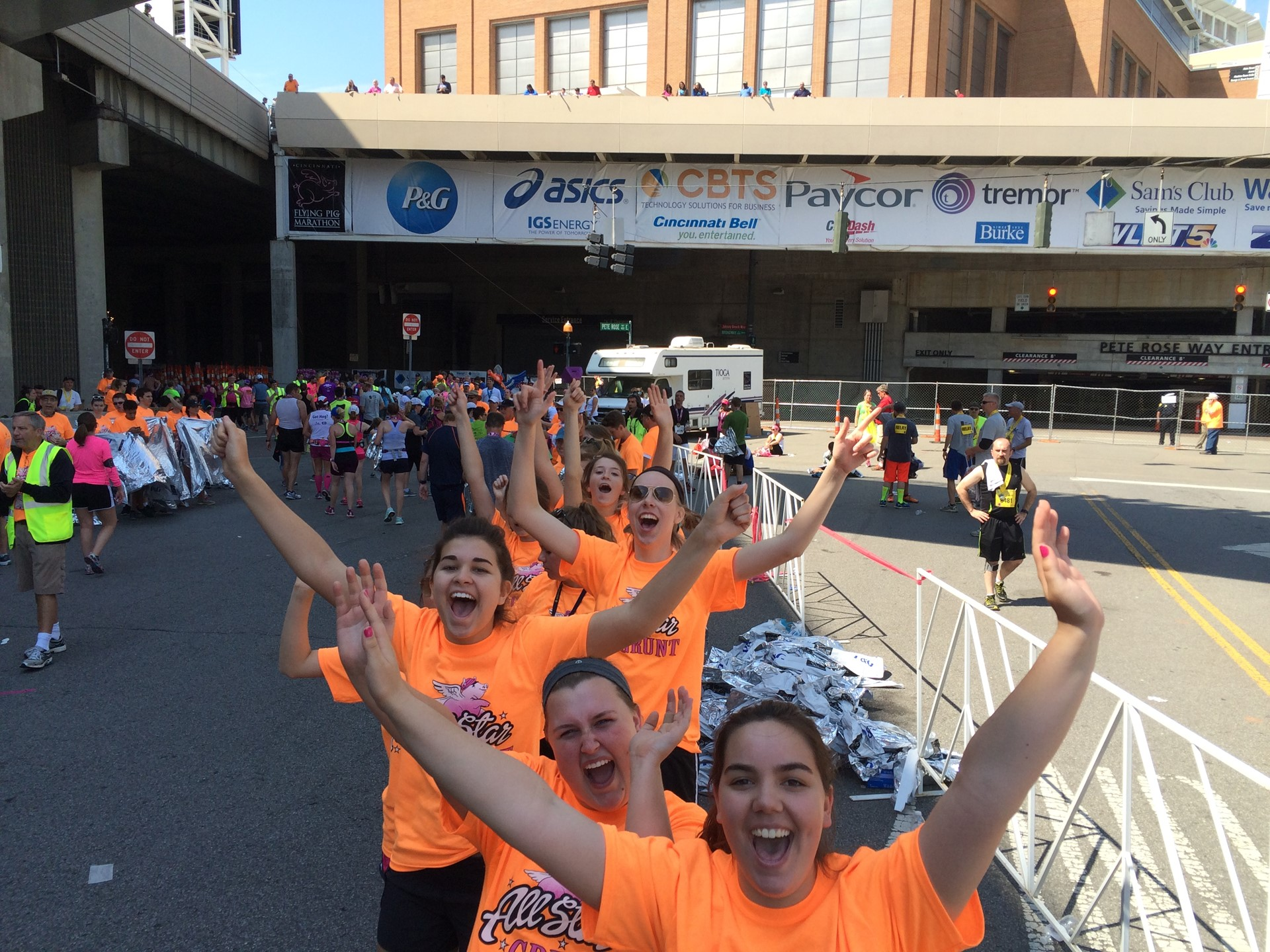 Several SUA students cheered on the runners of the Flying Pig Marathon
