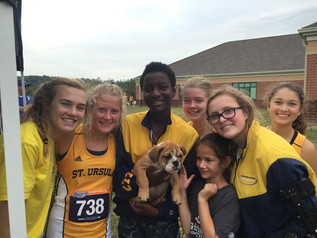 The Cross Country team gets into the Bulldawg spirit with a real bulldog!